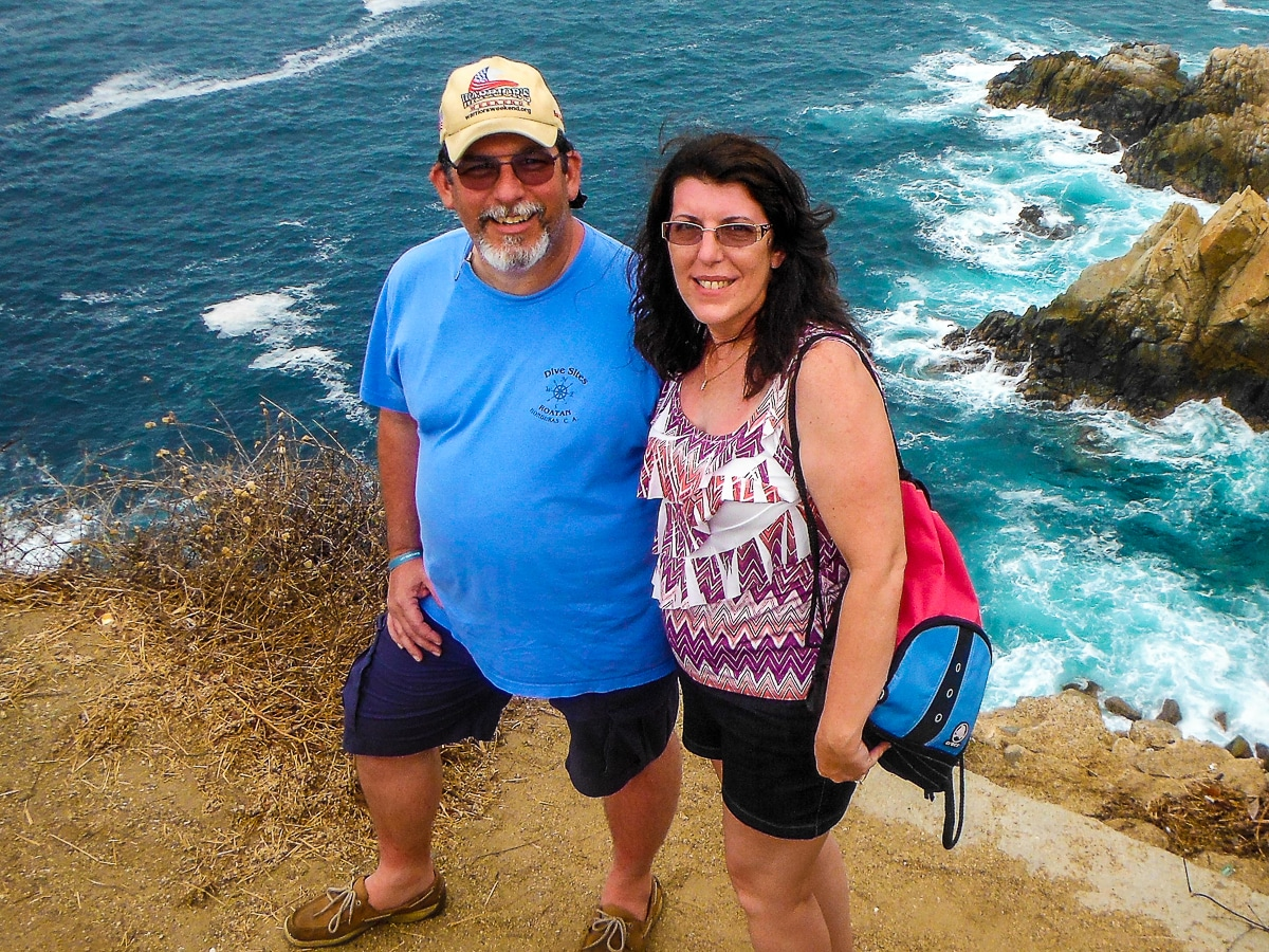 Charlie and Lynn standing on cliffs overlooking Pacific Ocean in Huatulco, Mexico