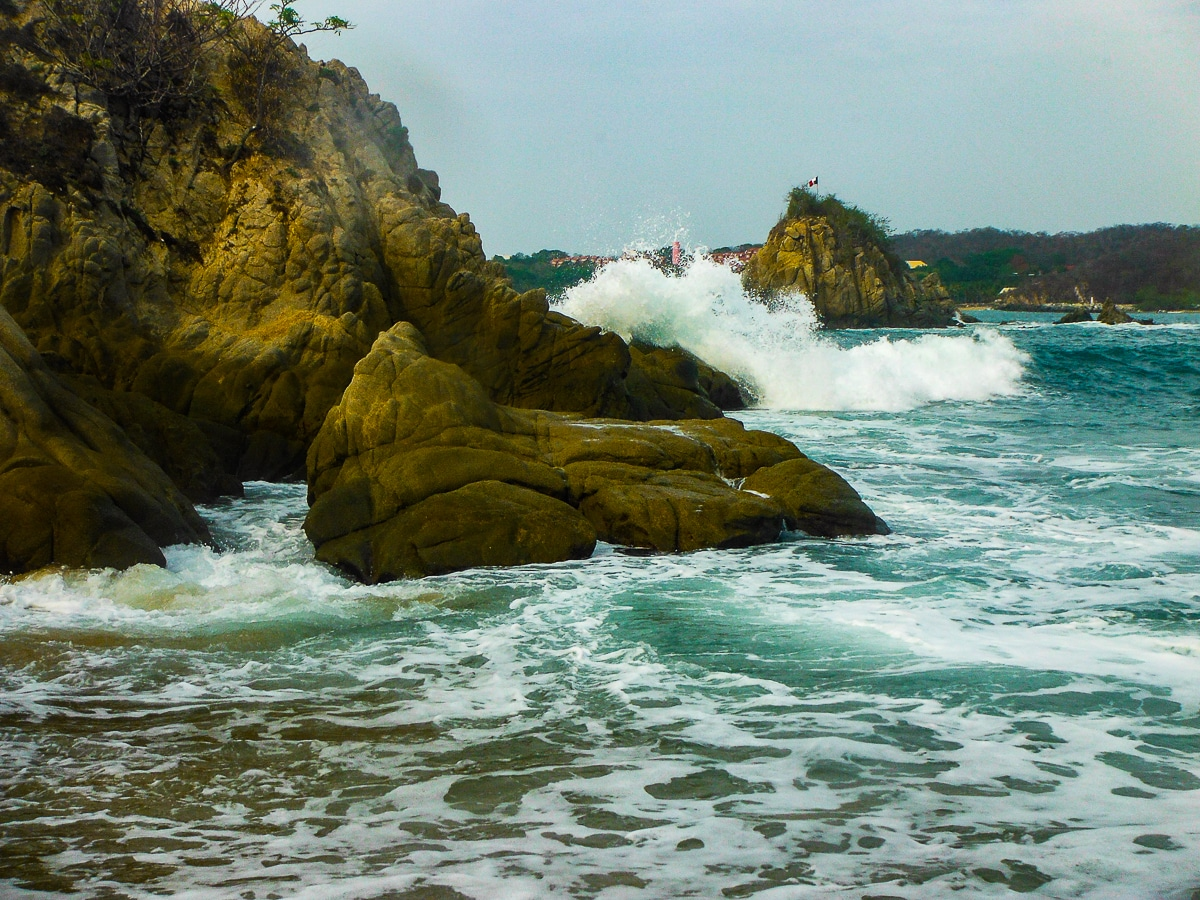Waves crashing into cliffs on coast of Mexico