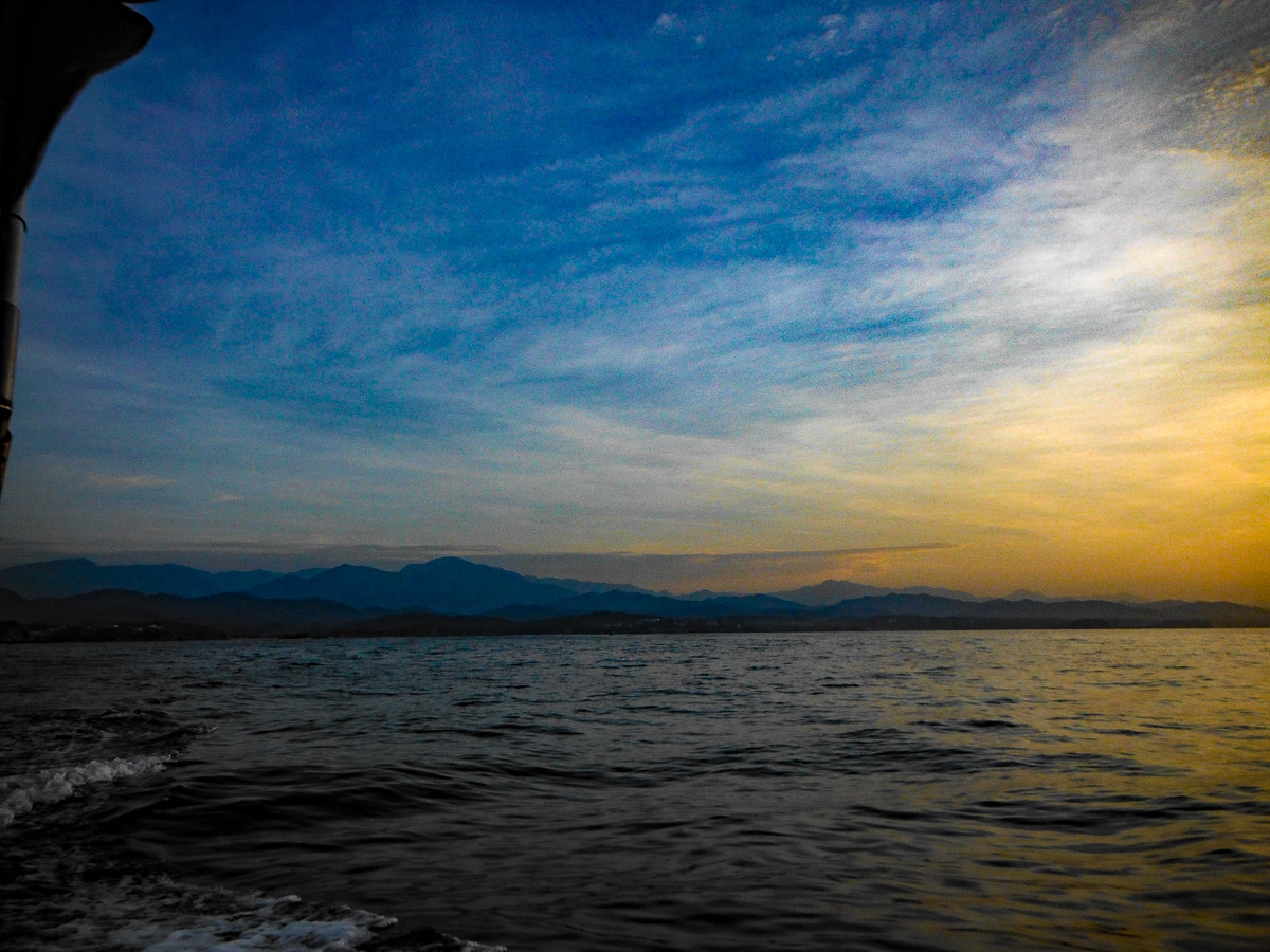 View of Sierra Madre Mountains in Mexico from fishing boat on Pacific Ocean at sunrise