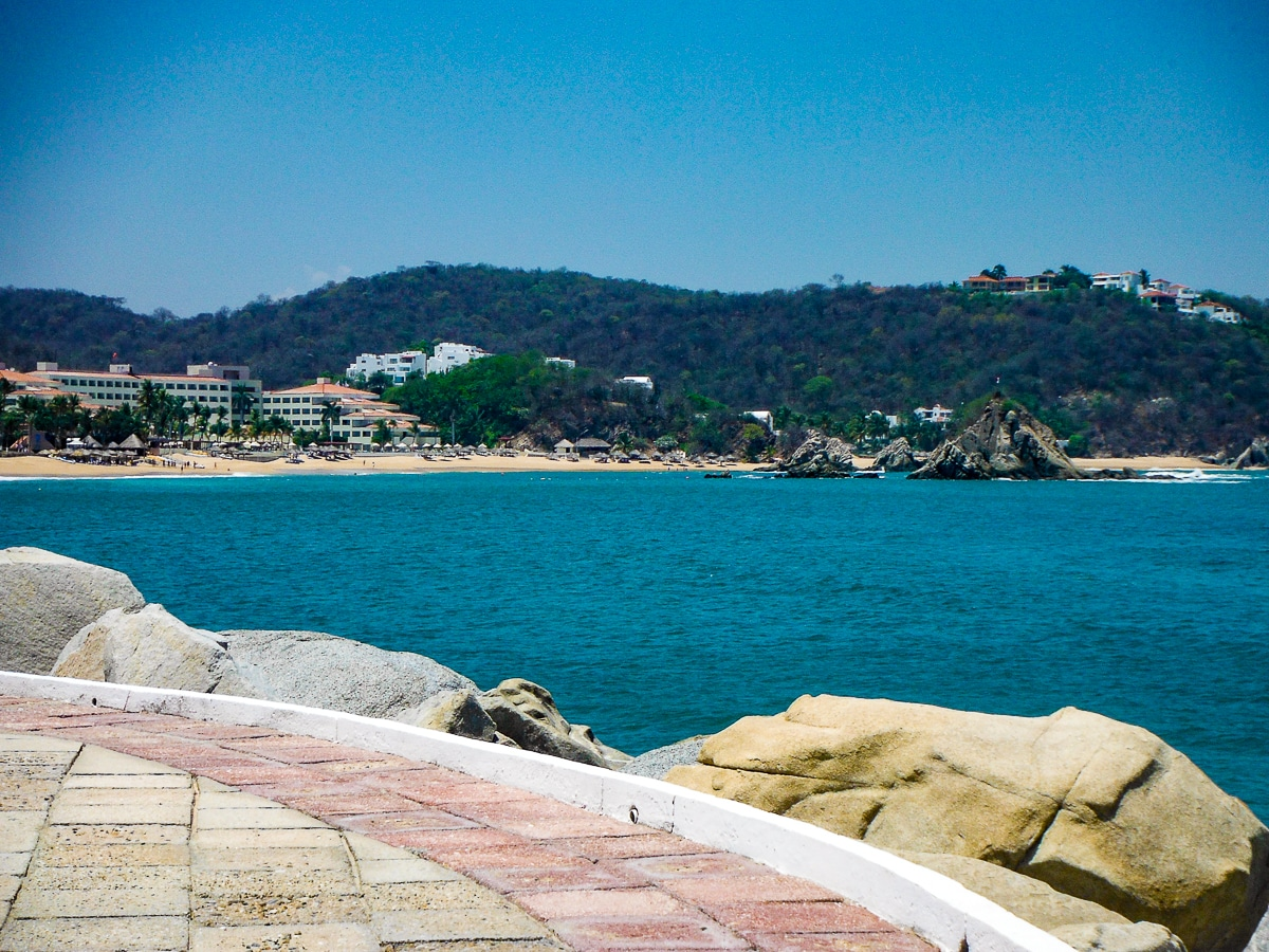 View of Barcelo Huatulco resort from vista on cliffs overlooking Pacific Ocean
