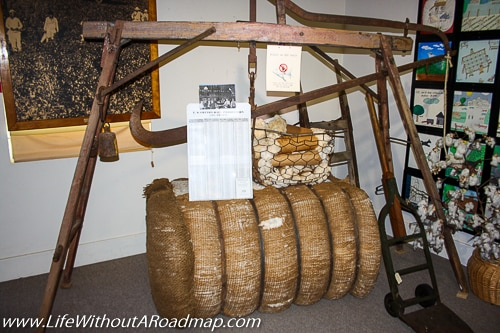 Bale of hay on scale in museum