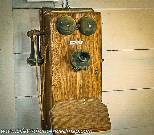 Antique phone on wall in cotton gin