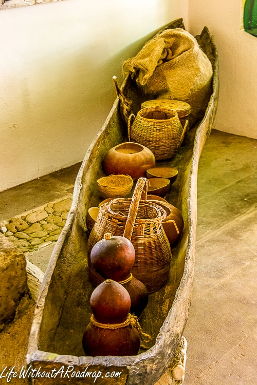Ancient hand carved canoe filled with artifacts in museum in Cozumel, Mexico
