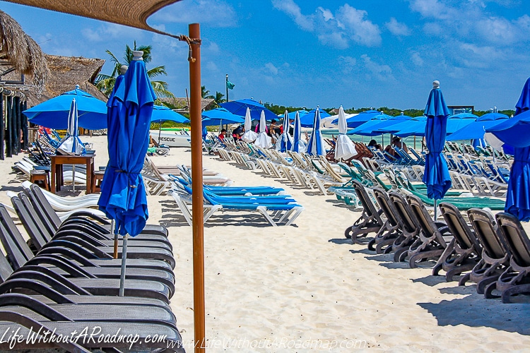 Rows and rows of white and blue beach chairs at Punta Sur beach club in Cozumel, Mexico