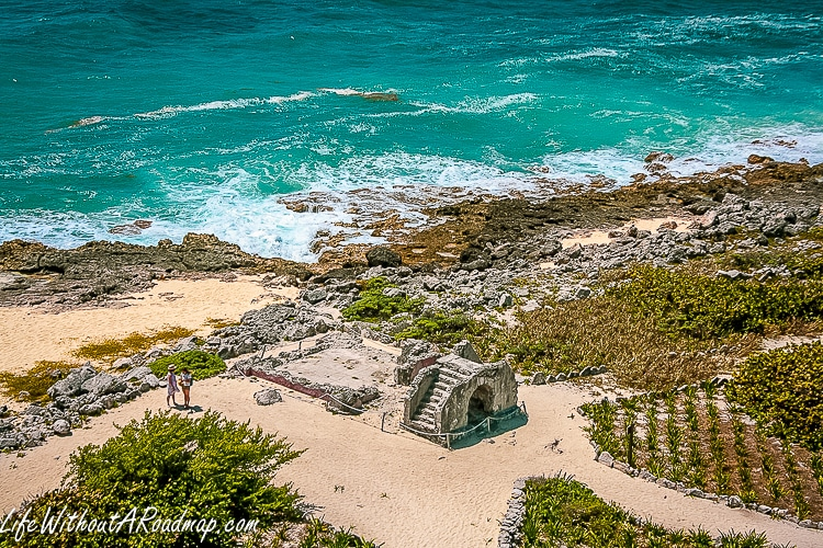 View of Myan ruins and blue Caribbean sea from top of lighthouse in Punta Sur