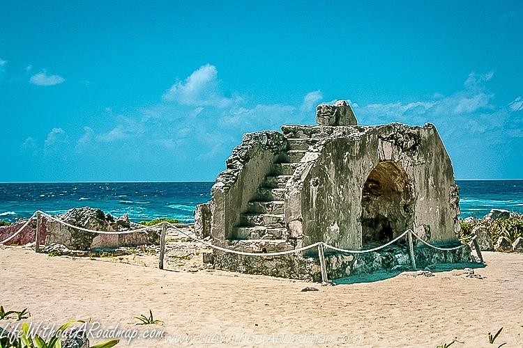 Myan Ruin with Caribbean Ocean in background